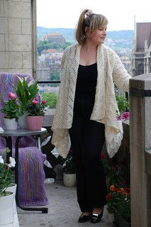Summary Lace pattern wrap worked from side to side in one piece with added sleeves.