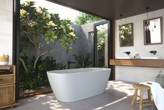 The Contura Freestanding Bath creates a striking focal point in any bathroom. Crafted from solid surface, this bath exudes warmth and is soft to the touch making it ideal for an indulgent and relaxing soak. Generous dimension and dual reclined ends make it the ideal bath for two. Combine with Caroma Contura basins for a beautiful timeless bathroom.