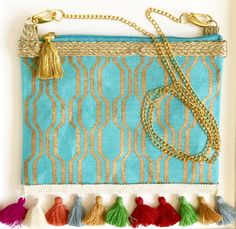 DAYDREAM! Tassel clutch with removable gold chain to make into a cross body!