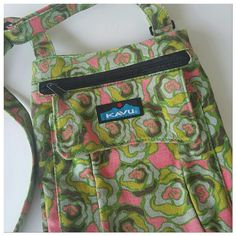 Kavu floral crossbody Super cute Kavu crossbody bag.  Pretty green background with lime and peachy pink flowers.  Zipper and velcro front pockets.  Well used, but lots of life left. kavu Bags Crossbody Bags