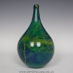 Handcrafted glass vase in the typical blue ochre Mdina colours Made by Mdina Glass on the island of Malta Signed on the base Mdina 1986 Signed Mdina