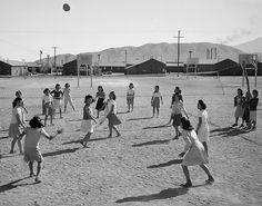 Ansel Adams: Volleyball game at Manzanar (Japanese-American Internment Camp), 1943.