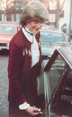 November 12, 1980: Lady Diana Spencer leaves Coleherne Court, aged 19 years old. Lady Diana wearing a burgundy reindeer cardigan.