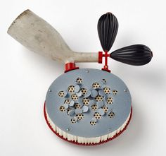 Holier Than Thou collection by Christel van der Laan  Brooch: Holy Smoke   Painted silver, ceramic honeycomb block, old clay pipe, vintage beads