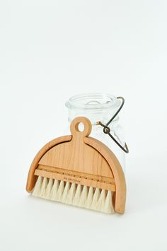 This small handmade table brush set is useful for sweeping up crumbs stuck in the ridges of wooden tables, or just for easily cleaning a table top or counter. Brush handle and pan made from oil treate