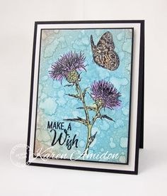 PaperLilies and Ink - I colored directly onto the rubber stamp with watercolor markers. I lightly spritzed with water and then stamped onto WC paper. The BG layer was colored with Distress Oxides and then embossed with the Floral BG die.  Serendipity Products Used 451K Thistle