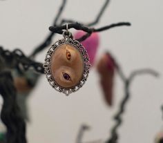 I have my Eyes on You Pendant by JewelReMotion on Etsy, $15.99