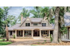 Pretty front elevation  Home Plan HOMEPW77025 is a gorgeous 5111 sq ft, 2 story, 5 bedroom, 5 bathroom plan influenced by + Shingle  style architecture.