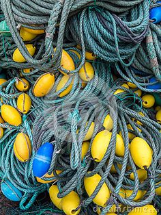 LUARCA, SPAIN - DECEMBER 4, 2016: Blue and yellow fishing gear at the fish market pier in Luarca, Spain.