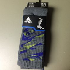 Adidas 2 pairs of Mens sizes 6-12 Camo Crew Socks NWT 2 Pairs of Adidas Mens Sizes 6-12 Camo Crew Socks. One pair is Purple the other is Gray both have the Neon green Camo on them Adidas Accessories Hosiery & Socks