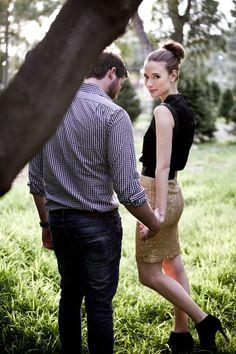 gold sequin skirt + ballerina bun + high collar black sleeveless top