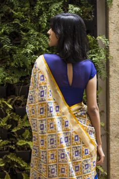 A stunning sheer yoke blouse in a rich ultramarine blue! A chiffon blouse with a sheer yoke and an intricate gold zardosi appliqué on one side with parrot worked in. A diva blouse this one!This blouse takes well to a myriad of pairings. A plain saree in a Indian Look, Indian Ethnic Wear, Ethnic Fashion, Indian Fashion, Saree Fashion, Fashion Blouses, Dress Fashion, Indian Attire, Indian Outfits
