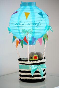 We built a hot air balloon and filled it with things a little newborn baby boy could need! Kuumailmapallo on hauska lahjaidea vastasyntyneelle tai baby shower -lahjaksi.