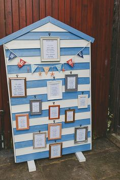 This fun table plan was made from an actual beach hut! Now that's up-cycling for you. Photo by Benjamin Stuart Photography #beachhut #beachwedding #tableplan