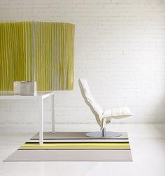 Woodnotes paper yarn carpet Horizon col. stone-yellow with Swivel narrow k chair.