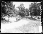 Chicago Daily News, Inc., photographer 1907.  View of automobile driver D. W. Cook (my -Diane Frymire's -great, great grandfather) driving a Gale automobile around a turn on a road in Algonquin, Illinois, during the Algonquin Hill Climbing Contest.  A group of spectators is standing and sitting beneath the shade of a tree on the side of the road.    NOTES  This photonegative taken by a Chicago Daily News photographer may have been published in the newspaper.    Cite as: SDN-05