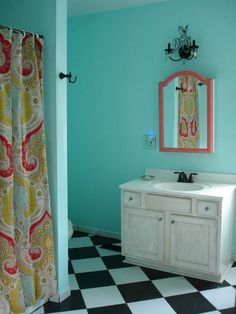 Black and white bathroom with turquoise and Echo Jaipur shower curtain.