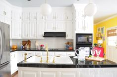 Brass is back!! Love this white and brass kitchen at The Pink Clutch featuring hardware for D. Lawless!