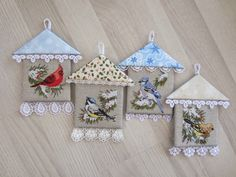 cross stitched bird with house ornaments