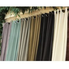 Ballard Indoor/Outdoor Curtain.  I love this idea for the back deck.  I would choose the green color!