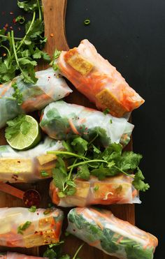 Simple, 10-ingredient Banh Mi-inspired spring rolls with crispy baked tofu, quick pickled veggies, and an easy vinegar dipping sauce.