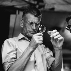 """Samuel Beckett on the set of his movie, """"Film"""", 1965 -by Steve Schapiro Looking at a fish, a parrot, etc… making a film via corbis"""