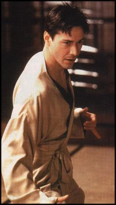 Neo - In the combat training program before Keanu Reeves starts his furious attacks on Morpheus, he rubs his nose with his thumb and finger, a similar mannerism of Bruce Lee before he attacks on his opponents. The move was improvised by Reeves.