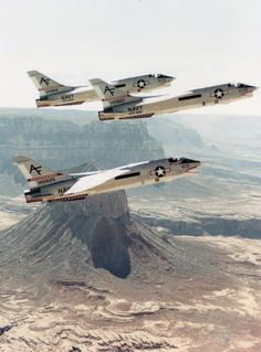 Three RF-8G Crusaders of aircraft of Light Photoreconnaissance Squadron (VFP) 206 pictured in flight over Monument Valley and the Grand Canyon on April 10, 1974