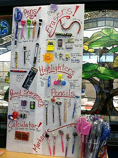 School Book Fair - display one of each pen, pencil, eraser, etc - and keep the containers behind a desk. Middle School Libraries, Elementary School Library, Elementary Schools, Library Lessons, Library Books, Library Ideas, Library Signs, School Store, School Fair