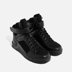 Zara BLACK STUDDED HIGH TOP SNEAKERS was $89.90, now 29.99. Alternative to Givenchy Tyson sneakers. Black high top sneakers with laces. Hook and loop closure at the ankle on the facing. Various textures and finishes on the upper with black studs. Geometric-design sole. Quilted ankle detail.