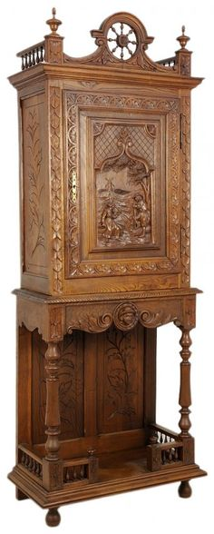 A WALNUT BRITTANY CABINET ON STAND : Lot 52