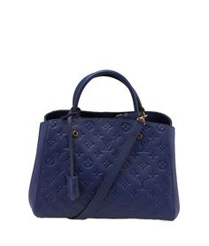 Louis Vuitton Montaigne MM Blue Empreinte Leather Tote--$2,932.50  http://www.cashinmybag.com/product/louis-vuitton-montaigne-mm-blue-empreinte-leather-tote/ #Louis #Vuitton #Handbags Buy this item now on our website! This Louis Vuitton Montaigne GM is new without tags, showing no signs of previous use. It features an interior clasp closure and a zippered compartment.