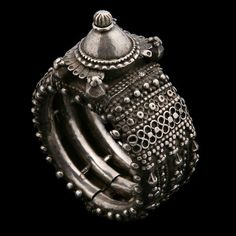 Silver Bracelet ~ Orissa, India ~ Circa 1900  ~   Unfasten the hinge, thread it onto your wrist or arm and become part of its 100-year history. Row after row of tactile pattern with a magnificent centrepiece, this bracelet's astonishing level of intricate detail makes it a piece to treasure forever.