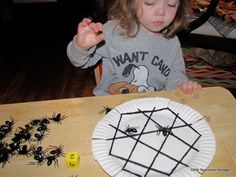 little learners lounge: halloween Paper plate, black yarn, plastic spiders and a home made die! Great blog! Cute Halloween game/activity! Could also be fun for a party or classroom and let them take home the game. They make the web and then teacher/ Mom/ Dad/Aide -  Some one calls the number and they place the spiders!