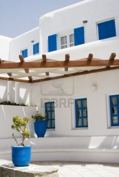 luv the typical greek architecture with the bright whites and blues!  typical architecture greek islands cyclades hotel mykonos Stock Photo
