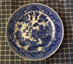The standard Willow pattern can be identified by the following rhyme: Two pigeons flying high, Chinese vessels sailing by, Weeping willows hanging o'er, Bridge with three men, if not four. Chinese temple, there it stands, Seems to take up all the land. Apple tree with apples on, A pretty fence to end my song. Weeping Willow, Willow Pattern, Apple Tree, Me Me Me Song, Apples, Fence, Temple, Sailing, Bridge