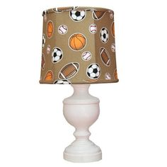Calling all sports fan designers, the All sports urn is the perfect boys room lamp in warm browns and cottage white finish at Jack and Jill Boutique