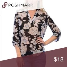 Black and white floral sheer blouse V-neck blouse.  Black and white floral top. Sheer.  Absolutely adorable Tops Blouses