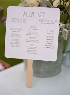 Program + Paddle Fan for a hot outdoor wedding.