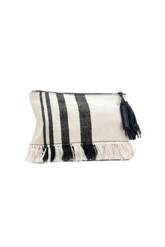 """Loeffler Randal Tassel Pouch in Woven Canvas The perfect size to tuck under your arm or slip into a tote this tasseled pouch is made from supple Clutch in black/white striped canvas with frayed edge. Loeffler Randall's signature stingray-print lining completes the look. Top zip closure. Interior wall pocket.  Measures: 11.25""""L x 1""""W x 8""""H   Canvas Tassel Pouch by Loeffler Randall. Bags - Clutches - Casual Alexandria Virginia"""