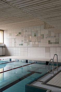 Folkform bases ceramic tile mural on Spånga town plan. Commercial Design, Commercial Interiors, Architecture Details, Interior Architecture, Indoor Swimming Pools, Tile Murals, Swedish Design, Built Environment, Public Art
