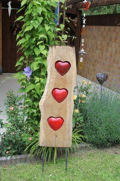 Gartendeko mit Herz aus Holz / wooden garden decoration with red hearts made by kunst-werk via DaWanda.com