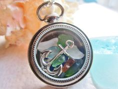 This nautical themed locket is perfect for displaying beautiful shards of sea glass. this listing has a pretty sterling silver anchor