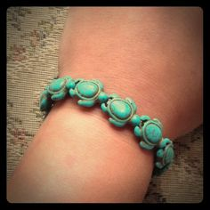 """Peermont Turtle Stretch Bracelet  Try this Peermont Turtle Stretch Bracelet on for size and get lost in its pure beauty that you'll love to show off. Inspired by nature's cutest little slowpoke, this detailed imitation turquoise bracelet offers a delicate touch to casual and formal outfits alike. Don't miss out on this cute deal today.   Want to know more? • Made with a stretch elastic band • Features imitation turquoise in a turtle design • Bracelet measures 7.7"""" L • Turtles measure 0.5"""" L…"""