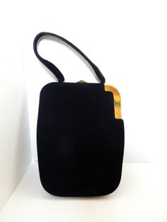 Gorgeous and Unique Vintage 40s KORET Koretolope Black Kid Suede Leather Handbag great condition. $58.95, via Etsy.