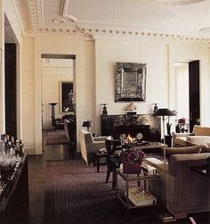 Valentino's London abode  designed by Jacques Grange  like the lamp shapes--very rich and enveloping room