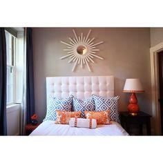 bedrooms - gray walls white sunburst mirror white tufted headboard blue diamonds pillows orange damask pillows glossy orange gourd lamp blue drapes found on Polyvore