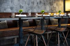 Nice color leather fabric, I like. The wood legs below look nice as well.    the elm restaurant, brooklyn