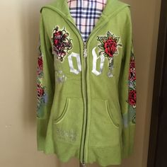 Ed Hardy Zipped Sweater Hoodie Size Large Worn previously this is a light green Ed Hardy sweater hoodie size Large.    I believe it fits closer to a medium size since the design is more of a boxed fit.  There are small forms of piling due to wearing however it is still in good condition.   All lapels on the sweater remain intact along with the zipper with the Ed Hardy symbol at the end of the zipper.   All offers accepted, sorry no trades. Ed Hardy Sweaters Cardigans