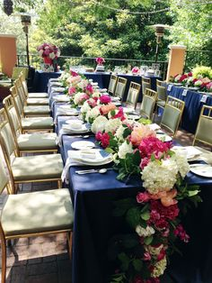 The long flower arrangement on a banquet table, all the colors are perfect